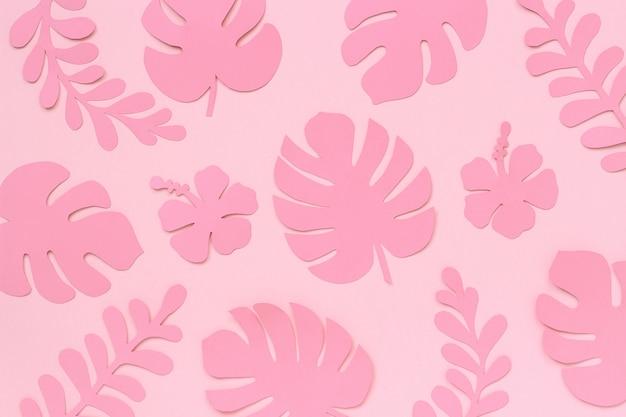 Modello di foglie tropicali rosa. foglie tropicali alla moda di carta su fondo. arte creativa della carta