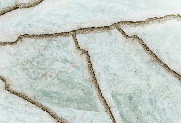Modello di marmo astratto di superficie del primo piano al fondo di pietra incrinato di struttura del pavimento di pietra