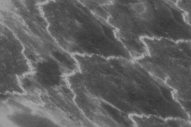 Modello di marmo superficiale del primo piano alla struttura della parete di pietra di marmo nero