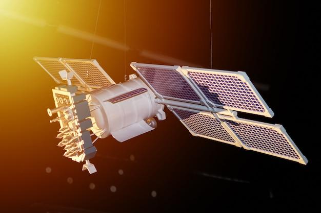 Modello di satellite spaziale su uno sfondo scuro