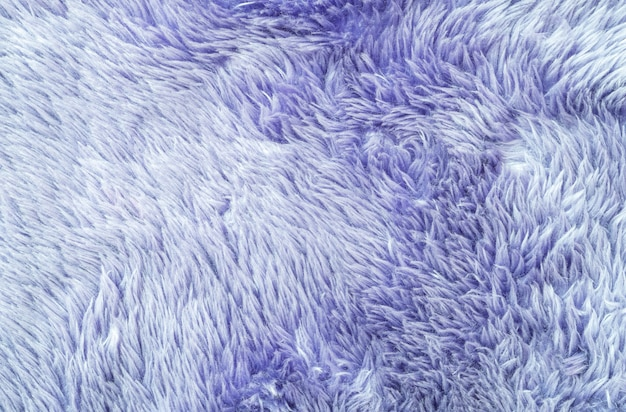 Modello di superficie astratta del tessuto del primo piano al tappeto di tessuto viola