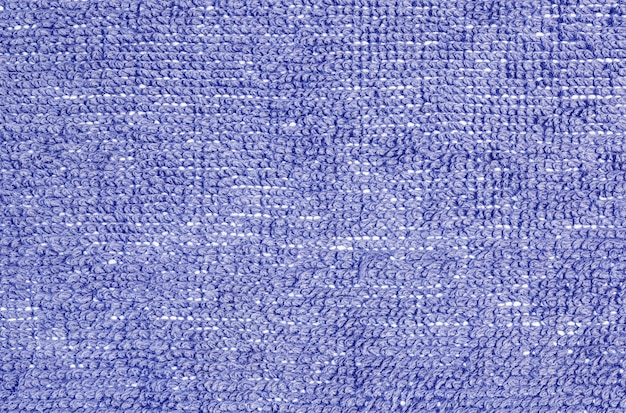 Modello di superficie del tessuto del primo piano al tappeto blu del tessuto al pavimento della struttura della casa