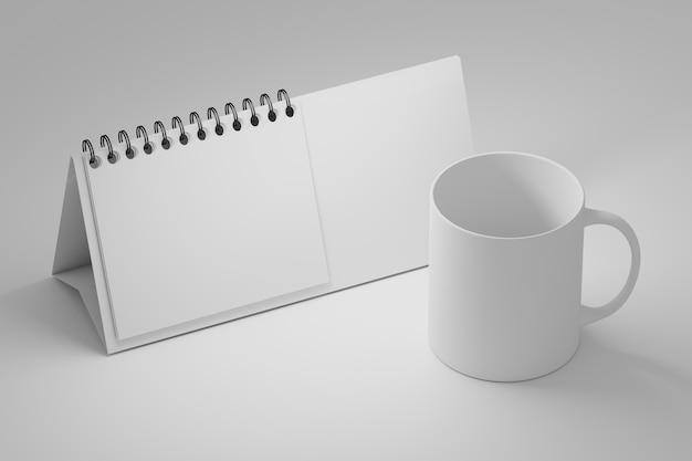 Modello di tavolo da ufficio con calendario a spirale in piedi bianco e tazza tazza da caffè in bianco su bianco