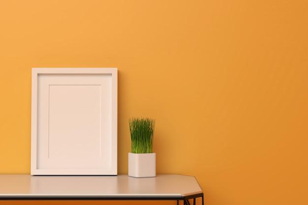 Modello in bianco della cornice nel salone di colore arancio con il piccolo albero sulla tavola.