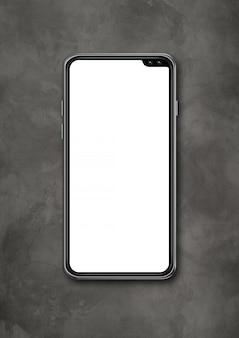 Modello in bianco moderno dello smartphone sul fondo concreto dello scrittorio. rendering 3d