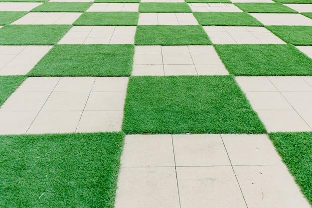 Modello quadrato di cemento ed erba