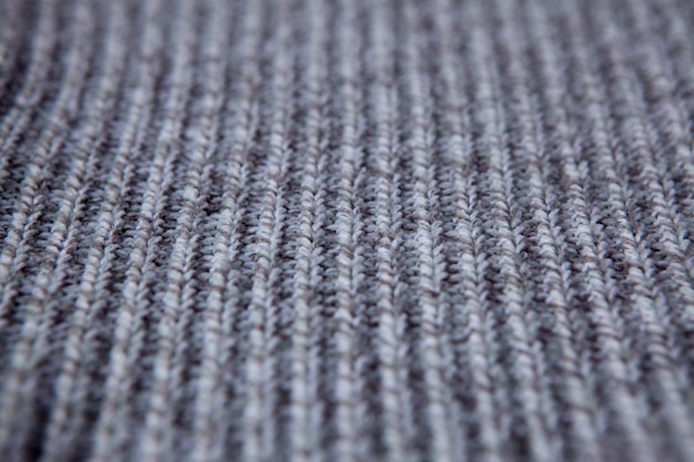 Modello senza cuciture a maglia. sfondo di lana grigia. maglia vecchia fatta a mano