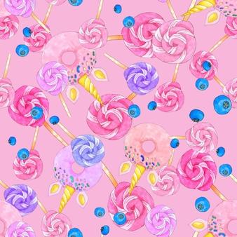 Modello senza cuciture con caramelle di zucchero, ciambelle a forma di unicorno e mirtilli su sfondo rosa brillante.