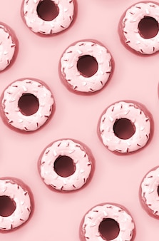 Molte piccole ciambelle di plastica si trova su uno sfondo colorato pastello