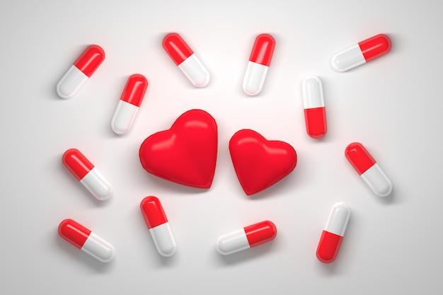 Molte pillole con cappucci rossi e bianchi e due cuori rossi al centro su bianco