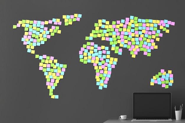 Molti adesivi incollati su un muro grigio scuro sotto forma di una mappa del mondo