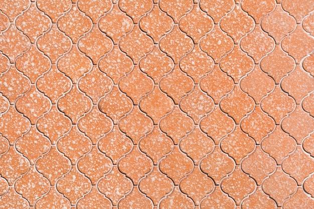 Mosaico in ceramica arancione