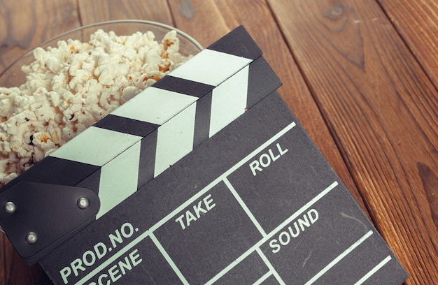 Movie clapper board in popcorn