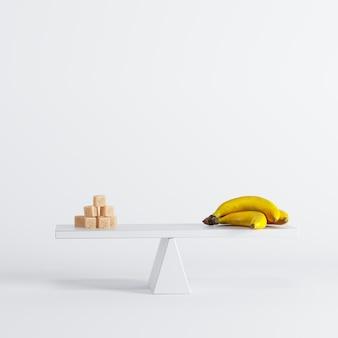 Movimento alternato della banana con gli zuccheri sull'estremità opposta su priorità bassa bianca. idea di cibo minimale.