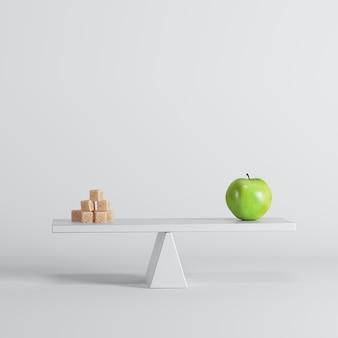 Movimento alternato verde della mela con gli zuccheri sull'estremità opposta su fondo bianco.