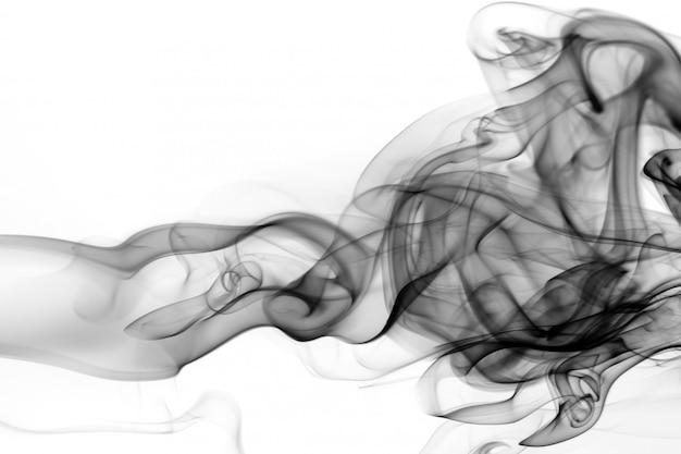 Movimento nero del fumo su fondo bianco, progettazione del fuoco