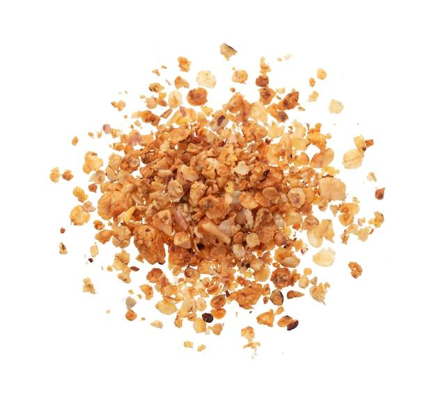 Mucchio di granola isolato su bianco, vista dall'alto