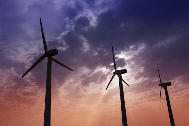 Mulini a vento aerogeneratore sul drammatico cielo al tramonto