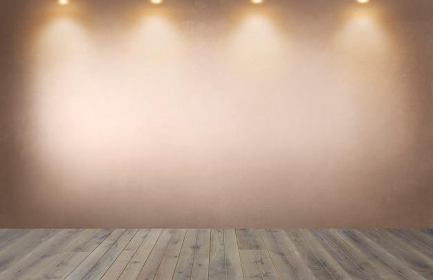 Muro arancione sbiadito con una fila di faretti in una stanza vuota
