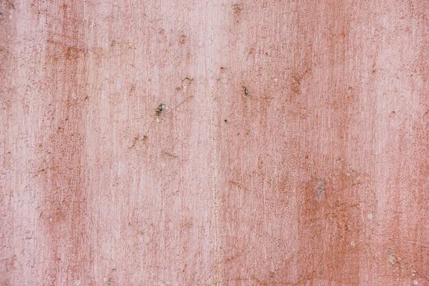 Muro di cemento astratto di struttura rosa