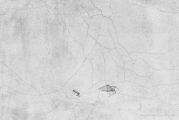 Muro di cemento con crepe e graffi