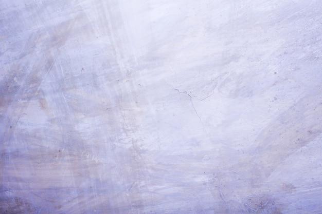 Muro di cemento con lo strato imbiancato, struttura della foto del fondo