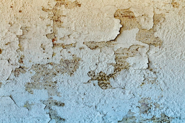 Muro di cemento incrinato per lo sfondo.