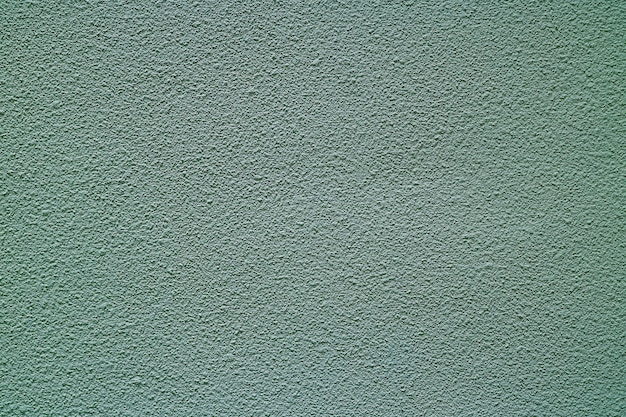 Muro di cemento ruvido colorato grigio blu, vista frontale per fondo, insegna, struttura