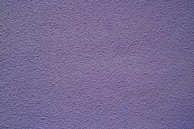 Muro di cemento ruvido nel colore porpora per il fondo di struttura