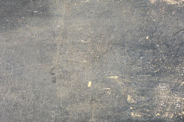 Muro di cemento sporco con macchie
