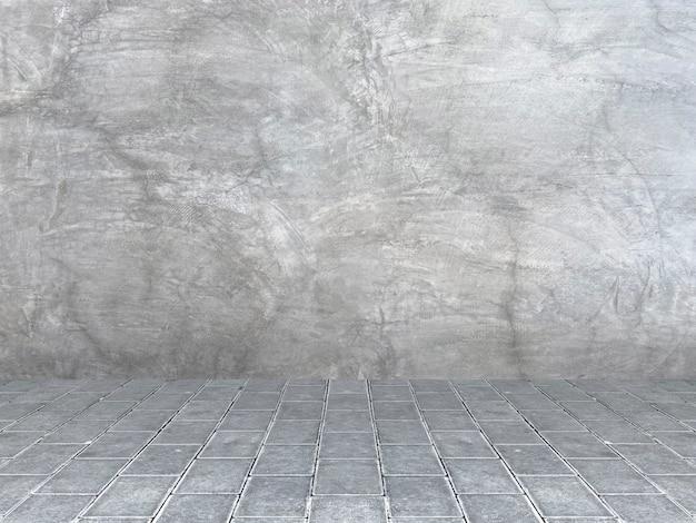 Muro di cemento stagionato e pavimento in mattoni