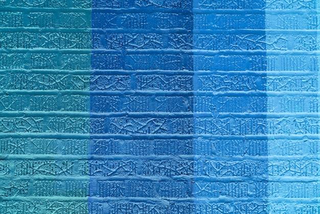 Muro di mattoni colorato blu astratto