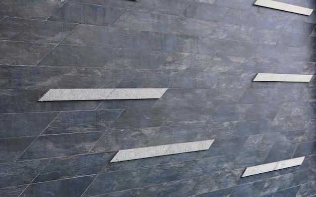 Muro di mattoni di marmo scuro di prospettiva con fondo della banda