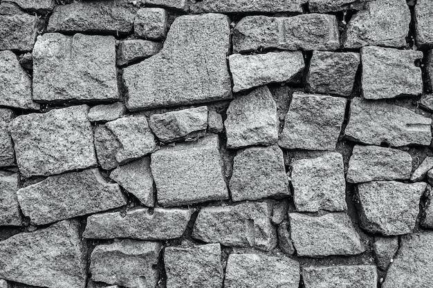 Muro di mattoni grigi