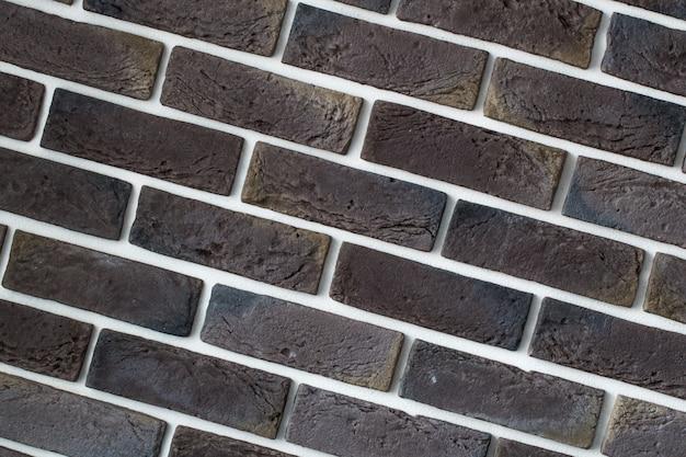 Muro di mattoni grigio chiaro, primo piano creativo back-phonon