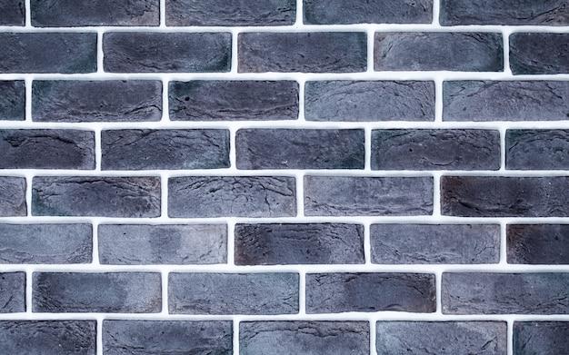 Muro di mattoni grigio chiaro