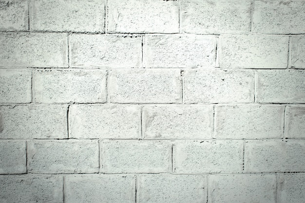 Muro di mattoni grigio stucco. trama di stucco con un motivo di mattoni. sfondo di cemento grigio