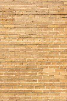Muro di mattoni invecchiato sullo sfondo
