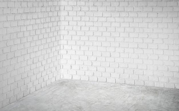 Muro di mattoni moderno bianco d'angolo vuoto e stanza di prospettiva grigia del pavimento di calcestruzzo, stanza moderna di stile