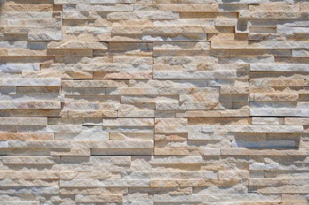 Muro di mattoni moderno per lo sfondo