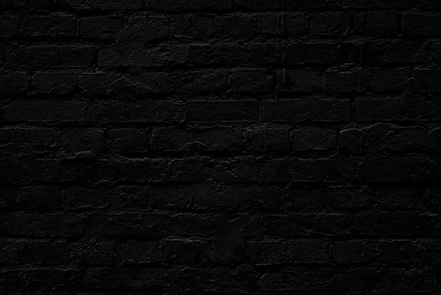Muro di mattoni nero. loft interior design. sfondo architettonico.