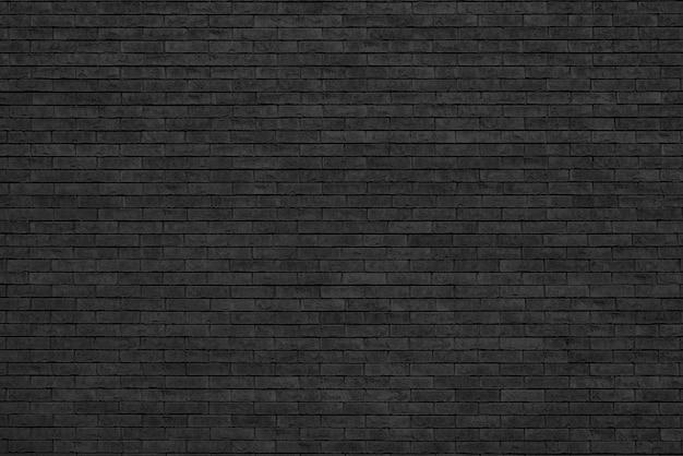 Muro di mattoni nero. loft interior design. vernice nera della facciata.