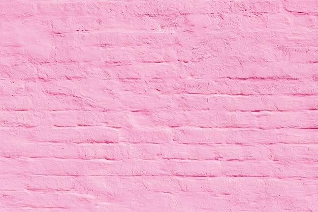 Muro di mattoni rosa dell'edificio. interno di un moderno loft. sfondo per la progettazione e la registrazione dell'intervista.