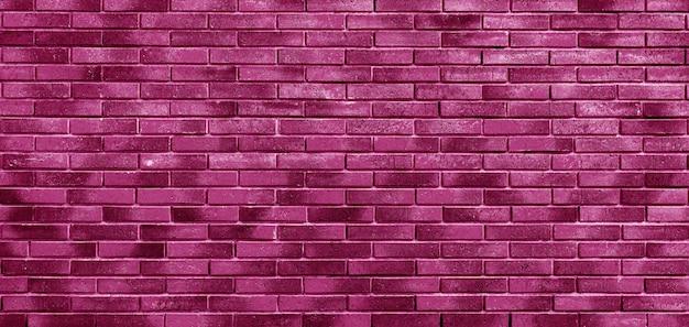 Muro di mattoni rosa. loft interior design. vernice rosa della facciata. sfondo architettonico.