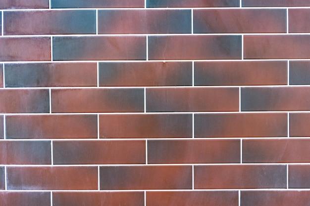 Muro di mattoni rossi. texture di marrone scuro e rosso mattone con ripieno bianco