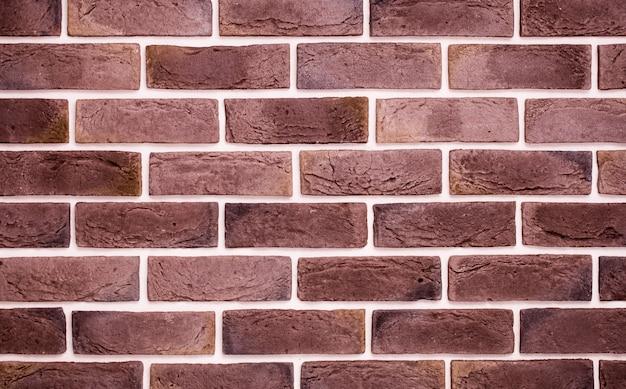 Muro di mattoni rosso chiaro, back-phonon creativo, primo piano