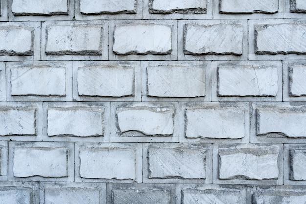 Muro di mattoni. texture di mattoni grigi con ripieno bianco