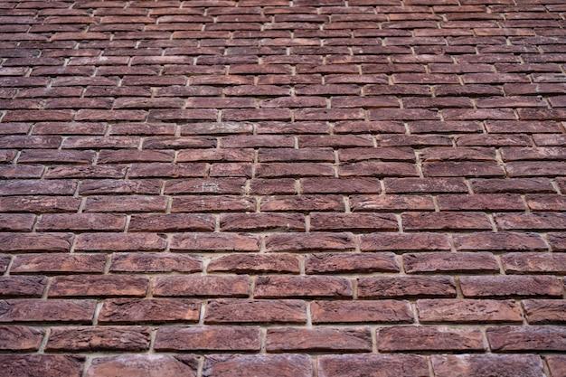 Muro di mattoni. texture di mattoni rossi con ripieno bianco