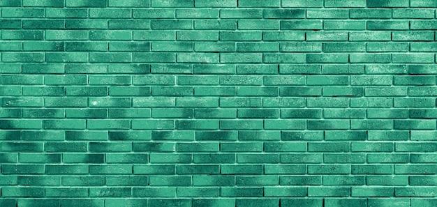 Muro di mattoni verdi. loft interior design. vernice verde della facciata.