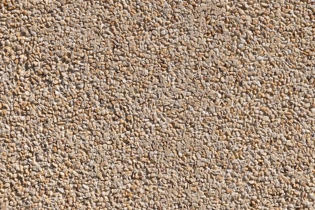 Muro di pietra beige con texture di sfondo